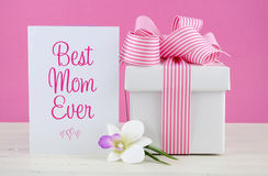 Happy Mothers Day pink and white gift with greeting card. Happy Mothers Day pink and white gift with Best Mom Ever greeting card, on white shabby chic royalty free stock photography