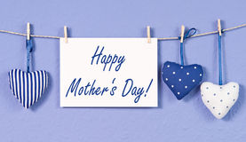 Happy Mothers Day. Postcard with text and some hearts on blue background stock photo