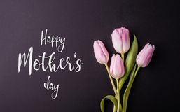 Happy mothers day sign and flowers composition. Studio shot. Stock Photo