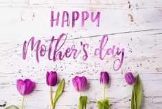 Happy mothers day sign and flowers composition. Studio shot. Stock Images