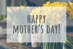 Happy mothers day. Text on blurred flowers background stock image