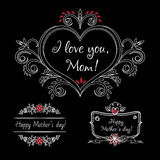 Happy mothers day vintage elements with flowers on chalkboard background. Mothers day label for print or website. Royalty Free Stock Images