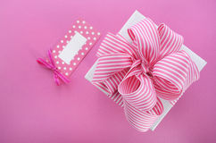 Happy Mothers Day white gift box with pink stripe ribbon. Royalty Free Stock Photos