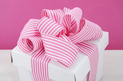 Happy Mothers Day white gift box with pink stripe ribbon. Stock Photo