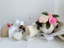Bouquet of roses, towel, silk ribbon on white background. stock image