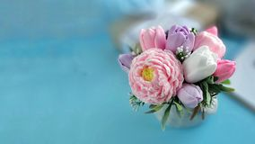 Bouquet of soap flowers on blurred blue background royalty free stock photo
