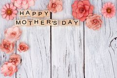 Happy Mothers Day wooden blocks with flower corner border Royalty Free Stock Photo