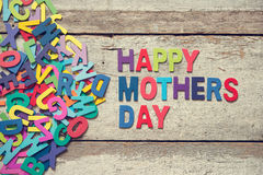 HAPPY MOTHERS DAY words. The colorful words HAPPY MOTHERS DAY on old wooden plank stock photography