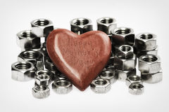 Happy Mothersday. Wooden heart surrounded with nuts Royalty Free Stock Images