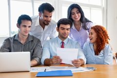 Happy motivated business team at work. At office Royalty Free Stock Images