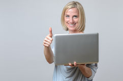 Happy motivated businesswoman giving a thumbs up Stock Image