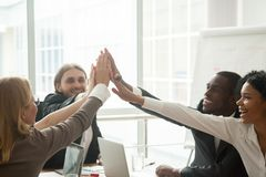 Happy motivated diverse business team giving high five at meetin. Happy motivated diverse business team giving high five together at meeting, excited multiracial Stock Photography