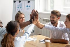 Happy motivated diverse members of business team join hands together royalty free stock image
