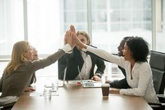 Happy motivated multiracial business team giving high five at me stock images