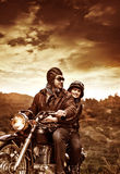 Happy motorcyclists in sunset Stock Images