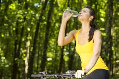 Happy mountain forest cyclist woman outdoors Stock Photos
