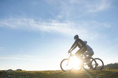 Happy mountainbike couple outdoors have fun together on a summer afternoon Royalty Free Stock Photos