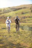 Happy mountainbike couple outdoors have fun together on a summer afternoon Stock Photos
