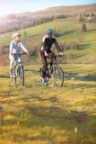 Happy mountainbike couple outdoors have fun together on a summer afternoon Royalty Free Stock Image