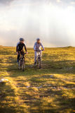 Happy mountainbike couple outdoors have fun together on a summer afternoon Stock Photography