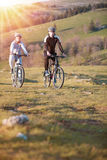 Happy mountainbike couple outdoors have fun together on a summer afternoon Stock Photo