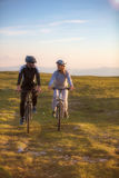 Happy mountainbike couple outdoors have fun together on a summer afternoon Royalty Free Stock Photography