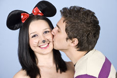Happy mouse girl being kissed Royalty Free Stock Images