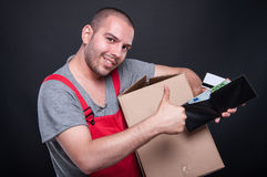 Happy mover man holding box money and card Royalty Free Stock Photos