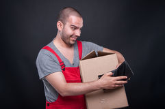 Happy mover man holding box and wallet Royalty Free Stock Photo