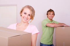 Happy moving couple Stock Photography