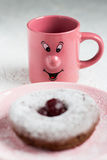 Happy Mug Looking at a Powdered Sugar Donut Royalty Free Stock Images