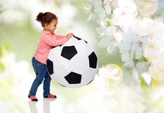 Happy mulatto little baby girl playing with ball Royalty Free Stock Photos
