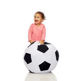 Happy mulatto little baby girl playing with ball Stock Photo