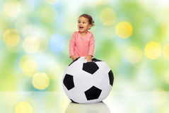 Happy mulatto little baby girl playing with ball Royalty Free Stock Photography