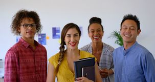 Happy multi-ethnic business colleagues standing together in modern office 4k stock video footage