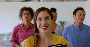 Happy multi-ethnic business colleagues walking together in modern office 4k. Portrait of multi-ethnic business colleagues standing together in modern office stock video footage