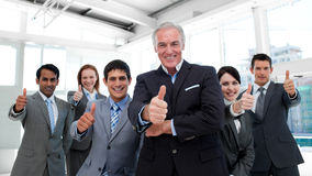 Happy multi-ethnic business team with thumbs up Royalty Free Stock Photos