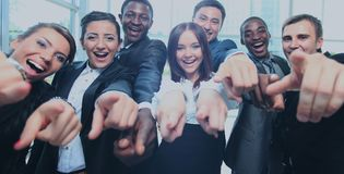 Happy multi-ethnic business team with thumbs up in the office Stock Images