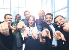 Happy multi-ethnic business team with thumbs up in the office Royalty Free Stock Images