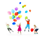Happy Multi-Ethnic Children Playing Balloons Together Stock Image