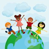 Happy multi ethnic kids standing on the earth. Royalty Free Stock Photos