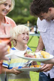 Happy multi-generation family enjoying barbecue Royalty Free Stock Photography
