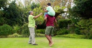 Multi-generation family having fun in garden 4k stock video