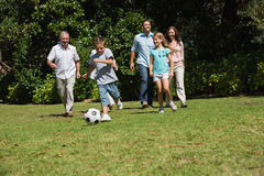 Happy multi generation family playing football Stock Images
