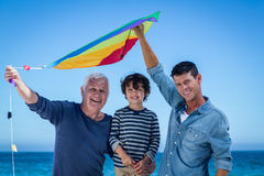 Happy multi generation family playing with a kite Royalty Free Stock Photography