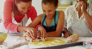 Happy multi-generation family preparing gingerbread in kitchen 4k
