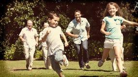 Happy multi generation family racing towards camera Stock Photos