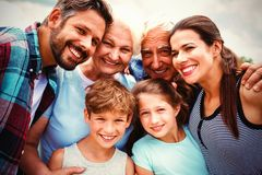 Happy multi generation family standing against sky royalty free stock photography