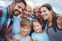 Happy multi-generation family standing outdoors. Portrait of happy multi-generation family standing outdoors royalty free stock photography
