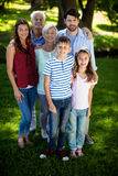 Happy multi generation family standing in park Royalty Free Stock Photo